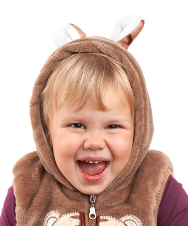 Portrait of funny laughing Caucasian baby girl in bear costume isolated on white photo