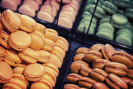 Colorful traditional French macarons lay  in the bakery photo