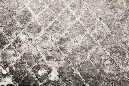 Dark gray old concrete wall with notching pattern. Background texture photo