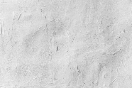 Old white concrete wall with plaster, background photo texture photo