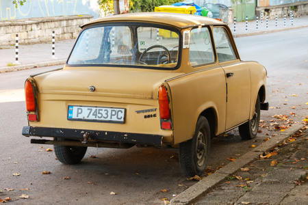 RUSE, BULGARIA - SEPTEMBER 29, 2014: Old yellow Trabant 601s car stands parked on a street side. It was the most common vehicle in East Germany