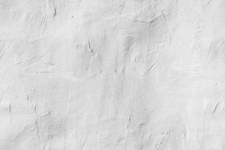 Old white concrete wall with plaster, seamless background photo texture
