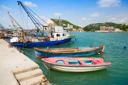 Fishing and small wooden boats are moored in port of Kavarna, Bulgaria photo