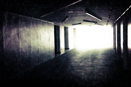 Abstract underground corridor interior with glowing end and wire-frame mesh photo