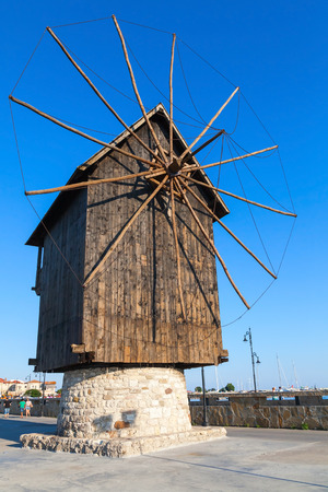 Ancient wooden windmill on the sea coast, the most popular landmark of old Nessebar town, Bulgaria
