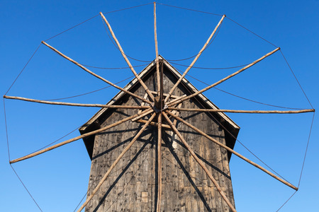 Ancient wooden windmill, the most popular landmark of old Nessebar town, Bulgaria photo