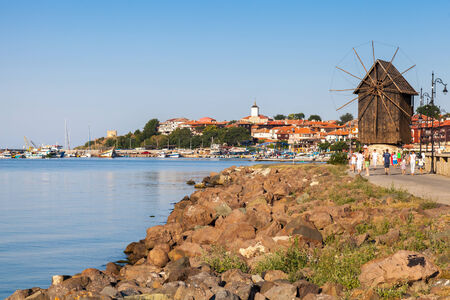 Coastal landscape with old windmill. Ancient town Nessebar, Bulgaria. Black Sea coast in sunny day