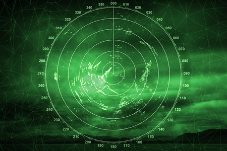 Green navigation system screen with illuminated radar image photo