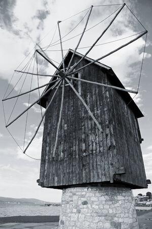 Old wooden windmill, the most popular landmark of old Nesebar, Bulgaria photo