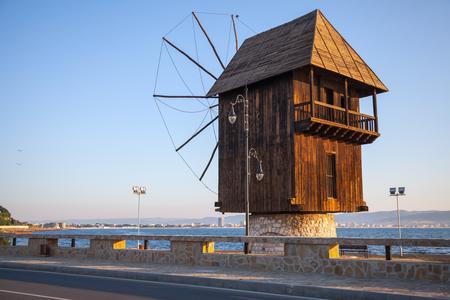 Old wooden windmill on the coast, the most popular landmark of old Nesebar town, Bulgaria photo