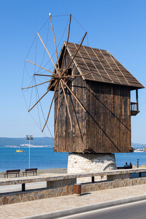 Old wooden windmill on the sea coast, the most popular landmark of old Nesebar town, Bulgaria photo