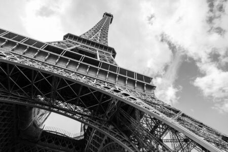 Looking up on Eiffel Tower, the most popular landmark of Paris, France. Monochrome photo photo