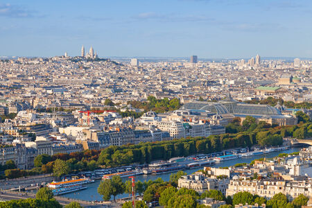 Birds eye view from Eiffel Tower on Paris city, France with Sacre Coeur cathedral on the horizon photo