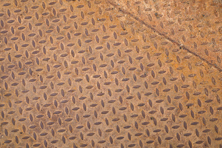 Rusted steel sheet with diamond pattern, background texture photo