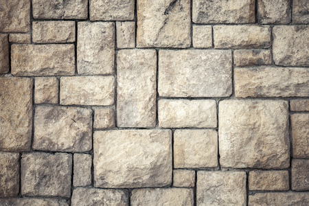 Vintage background photo texture of old brown decorative stone wall