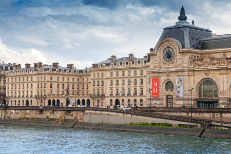 Paris, France - August 07, 2014: Seine river view, facade of the Orsay modern art Museum in Paris, France
