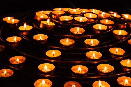 dark interior: Candles burn in dark interior of Catholic cathedral