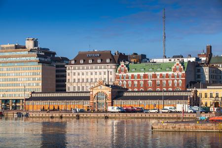 gustaf: Helsinki, Finland - September 14, 2014: Central quay of Helsinki with oldest city market hall opened in 1889. The building was designed by Gustaf Nystrom. Popular landmark
