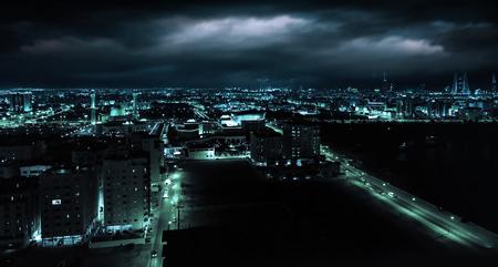 Blue toned photo. Night view of Manama, capital city of Bahrain, Middle East photo