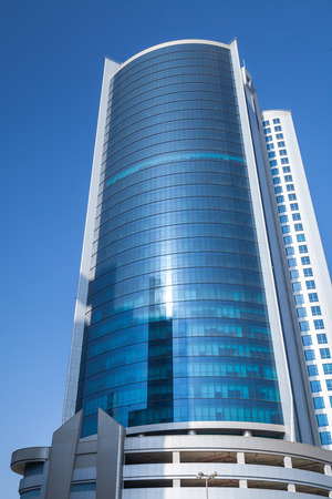 diplomat: Manama, Bahrain - November 21, 2014: Diplomat Commercial Office Tower in Manama city on blue sky background Editorial