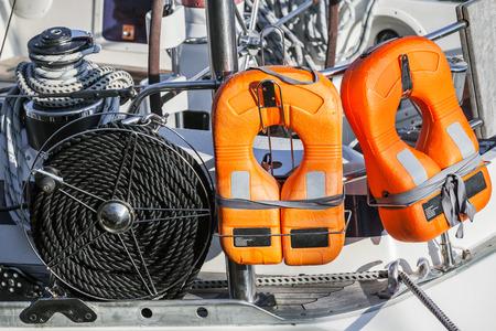 safety jacket: Orange lifebuoys and black rope, safety equipment of modern yacht Stock Photo