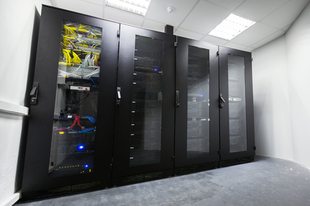 cabinets: Modern server room interior with black metal computer cabinets