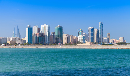 Bahrain: Modern office buildings and hotels in the sunny day. Skyline of Manama city, Bahrain