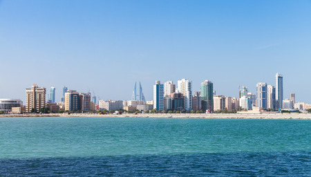 Modern tall buildings on the horizon. Skyline of Manama city, Bahrain photo
