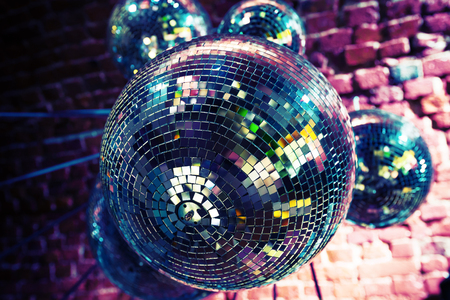 magic ball: Colorful disco party background with mirror balls reflecting lights
