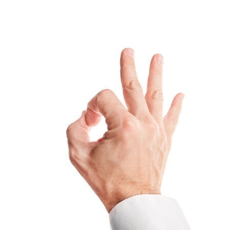 acceptance: Closeup photo of business man hand showing ok acceptance sign isolated on white background