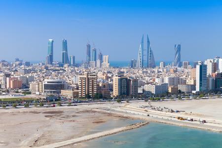 persian gulf: Bird view of Manama city, Bahrain. Skyline with modern skyscrapers standing on the coast of Persian Gulf