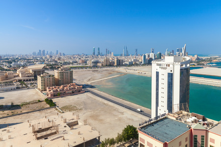 bird view: Manama, Bahrain - November 20, 2014: Bird view of Manama city, Bahrain. Skyline with modern buildings standing on coast of Persian Gulf