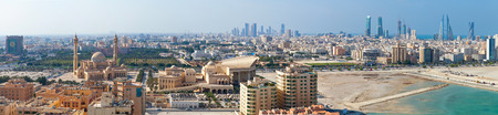 bird view: Manama, Bahrain - November 20, 2014: Bird view wide panorama of Manama city, Bahrain. Skyline with old buildings, Grand Mosque and modern skyscrapers on the coast of Persian Gulf