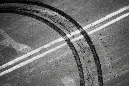 dividing lines: An illegal maneuver concept. Crossing of double dividing lines road marking and tires track
