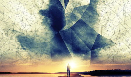 A man walks to the sun under digital 3d polygonal wire-frame sky structure Stock Photo