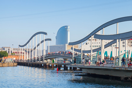 Barcelona, Spain - August 26, 2014: Vista port view with walkway Bridge and a lot of walking people