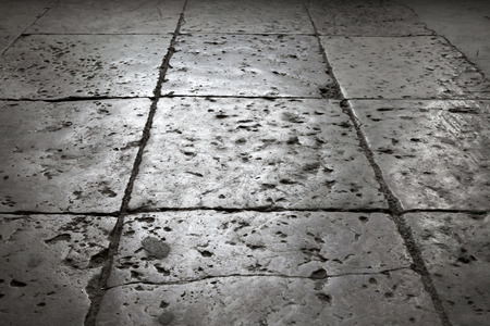 Dark gray stone tiling on the floor, background with perspective effect photo