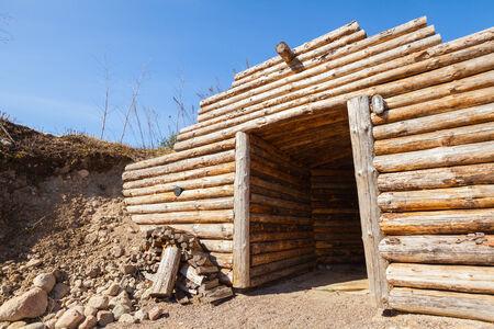 finland sauna: Wooden wall and open door of old traditional underground sauna in Finland Stock Photo