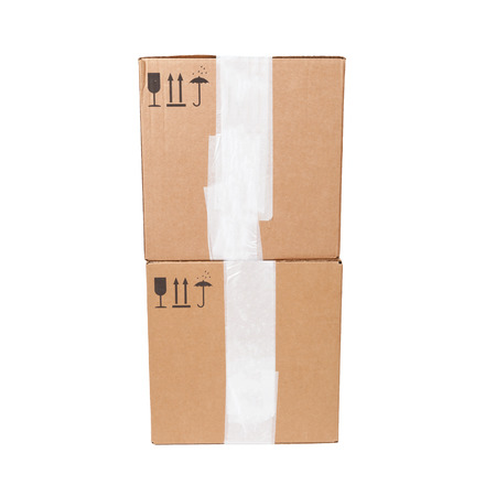 Two cardboard boxes with standard black signs isolated on white background photo