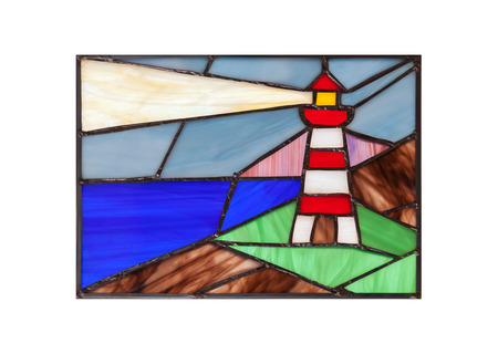 Handmade stained glass composition with abstract coastal landscape and lighthouse