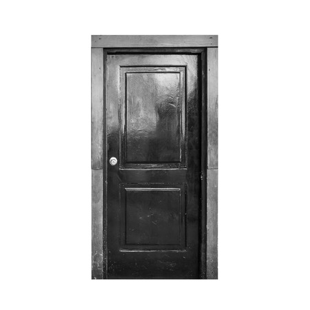 front door: Old black wooden door isolated on white background Stock Photo