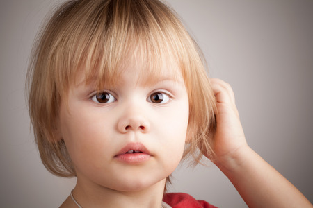 Closeup portrait of cute blond baby girl Stock Photo