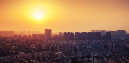 Bright colorful sunrise over big city panorama. Vintage toned photo with filter effect photo