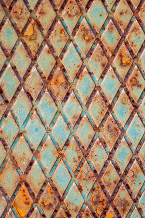 diamondplate: Rusted green steel plate with relief pattern, background photo texture