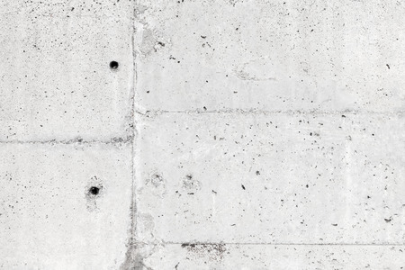 White concrete wall with details, background photo texture photo