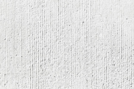 Rough white concrete wall background texture with vertical relief lines