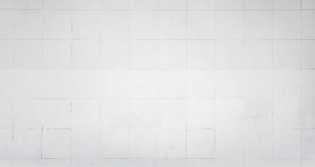 tiling: White wall with tiling. Background photo texture