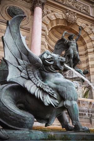 winged lion: Winged lion. Fontaine Saint-Michel in Paris, France. Popular historical landmark Stock Photo