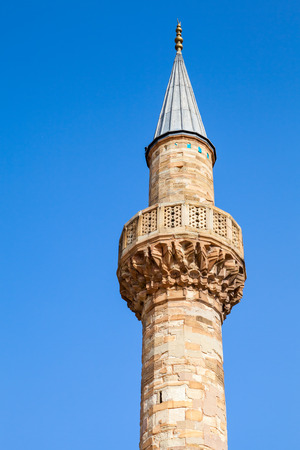 camii: Minaret of ancient Camii mosque. Central Konak square, Izmir, Turkey Stock Photo