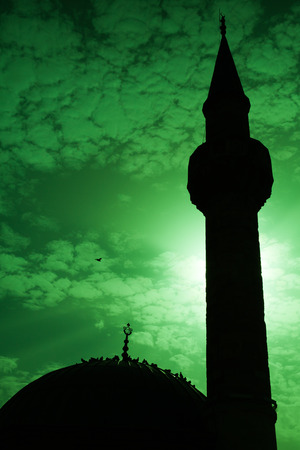 camii: Minaret of ancient Camii mosque, Konak square, Izmir, Turkey. Green toned photo